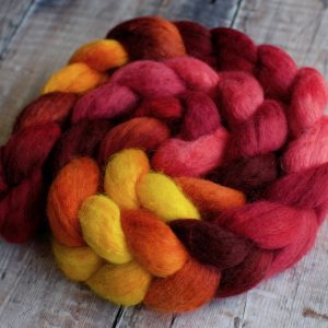 Coiled, braided wool roving